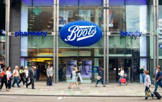 People walking in front of the Boots pharmacy in London